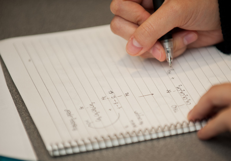 A physics student takes notes during a tutoring session at Fairfax Campus. Photo by Alexis Glenn/Creative Services/George Mason University