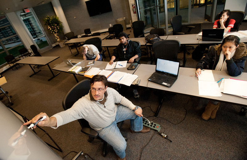 Radleigh Smith tutors physics students, as part of the Accelerator program at Fairfax Campus. Photo by Alexis Glenn/Creative Services/George Mason University
