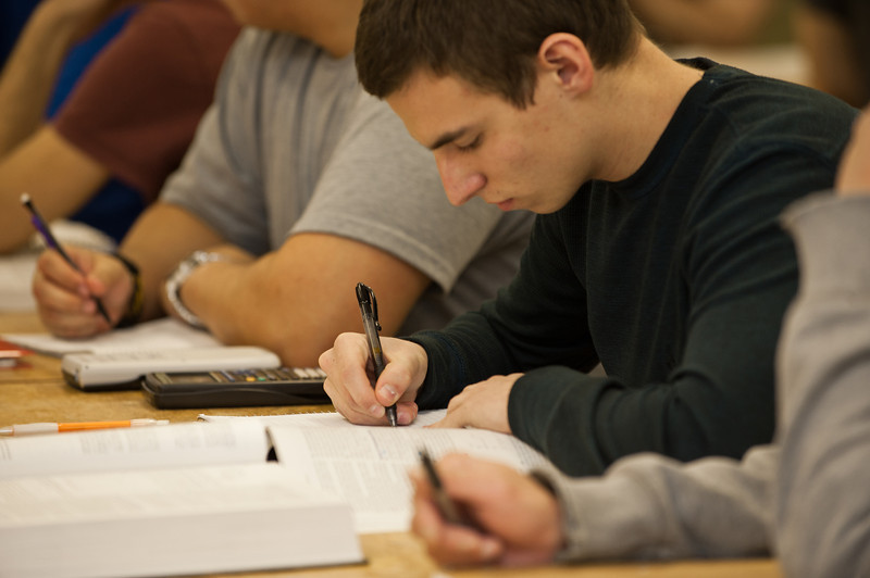 A University Physics student takes notes during class at Fairfax Campus. Photo by Alexis Glenn/Creative Services/George Mason University