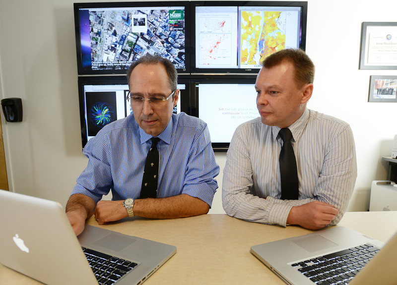 Tony Stefanidis and Jacek Radzikowski working at the Center for Geospatial Intelligience. Photo by Evan Cantwell/Creative Services/George Mason University