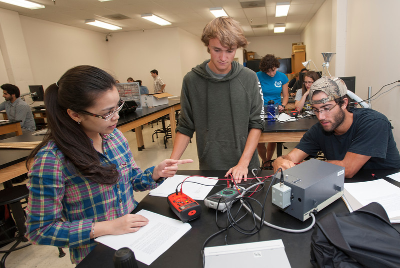 Students in a physics lab perform an experiment on the photoelectric effect at Fairfax campus. Photo by Alexis Glenn/Creative Services/George Mason University