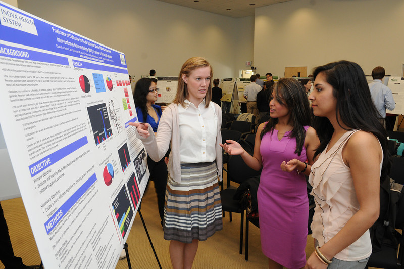 Student Elizabeth A. Benkert presenting her poster at the College of Science Undergraduate Research Colloquium. Photo by Evan Cantwell/Creative Services/George Mason University