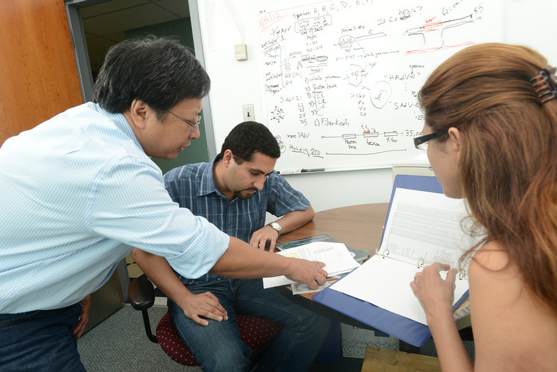 (left to right) Professor Donald Seto works with Amir Shams, graduate student, and visiting Professor Shoaleh Dehghan.  Photo by Evan Cantwell/Creative Serivces/George Mason University