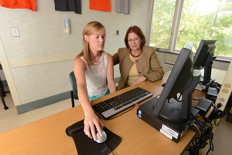Beverly Walters, M.D., Inova director of clinical research supervises Mason student Elizabeth Benkert in the Mason-Inova neuroscience internship program. Photo by Evan Cantwell/Creative Services/George Mason University