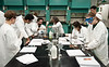 Professor Golala Arya teaches an undergraduate chemistry lab.  Photo by Alexis Glenn/Creative Services/George Mason University