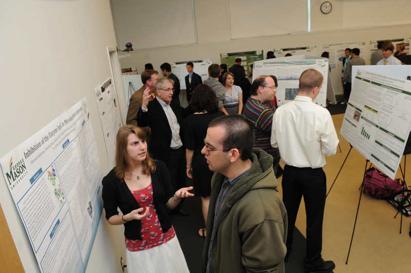 Students present research posters at the College of Science Undergraduate Research Colloquium. Photo by Evan Cantwell/Creative Services/George Mason University