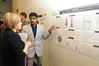 Student Muhammad A. Mansoor presenting a research poster at the College of Science Undergraduate Research Colloquium. Photo by Evan Cantwell/Creative Services/George Mason University