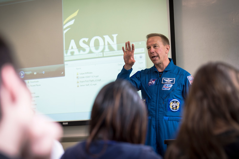 Astronaut Timothy L. Kopra speaks to the Mason community after returning from the International Space Station
