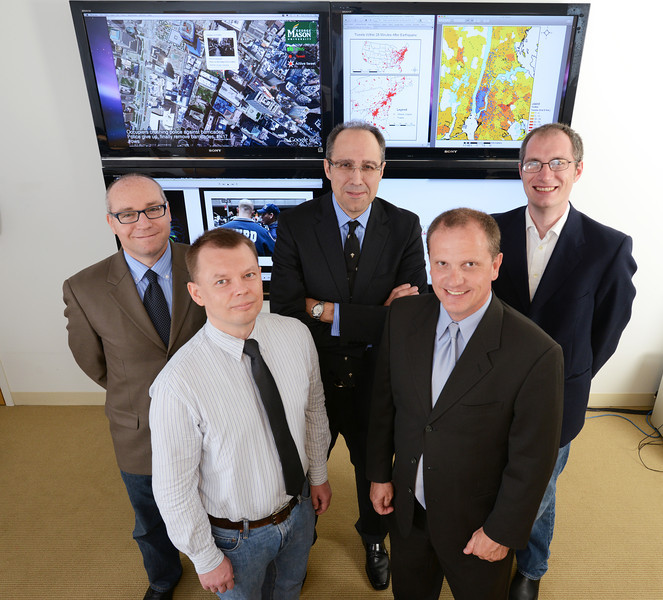 Center for Geospatial Intelligience group photo. Front Row Left to Right: Jacek Radzikowski, Matt Rice. Back Row Left to Right: Arie Croitoru, Tony Stefanidis, Andrew Crooks. Photo by Evan Cantwell/Creative Services/George Mason University