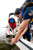 110922515 - Smithsonian-Mason Semester for Conservation Studies program students gather samples as they participate in a watershed conservation and management field trip to Gunston Cove at Pohick Bay Regional Park in Virginia. Photo by Alexis Glenn/Creative Services/George Mason University