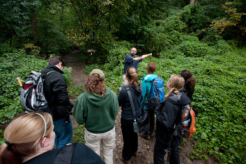 Professor Jim McNeil directs students of the Smithsonian-Mason Semester for Conservation Studies program as they participate in an urban entomology lab field trip to Rock Creek Park in Washington DC. Photo by Alexis Glenn/Creative Services/George Mason University