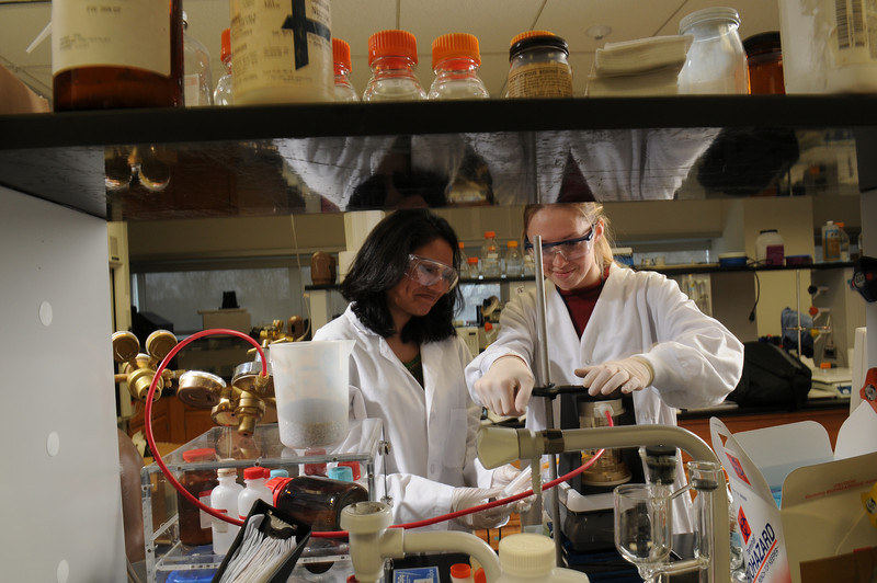 Students Minu Ramanan and Galina Karmen in the lab on the Prince William campus.  Photo by Evan Cantwell/Creative Services/George Mason University