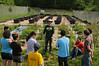 Students enrolled in Dr. Changwoo Ahn's Ecological Sustainability course get hands-on experience planting wetland plants. Photo by Evan Cantwell/George Mason University