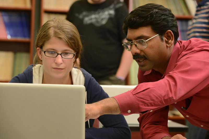 Associate Professor Padmanabhan Seshaiyer mentors Marissa Soucy from Simmons College in the multidisciplinary REU Program: Research experience for undergraduates sponsored by the Department of Mathematical Sciences.  Photo by Evan Cantwell/Creative Services/George Mason University