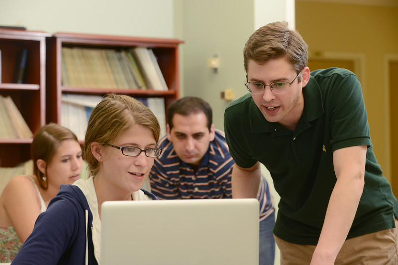 Right to left: Tyrus Berry, graduate student with Marissa Soucy from Simmons College participating in the multidisciplinary REU Program: Research experience for undergraduates sponsored by the Department of Mathematical Sciences.  Photo by Evan Cantwell/Creative Services/George Mason University