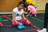 Girls learn about robotics through a hands-on experience at the STEM-FOCUS camp. Photo by Bethany Camp / Creative Services / George Mason University
