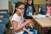 Girls at the STEM-FOCUS camp learn about 3D printing and do an engineering activity where they create structures using straws and 3D printed joints. With the help of undergraduate students, they test the durability of their structures by seeing if the structures can support the weight of other 3D printed objects. Photo by Bethany Camp / Creative Services / George Mason University