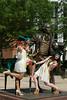 Graduates posing at the George Mason statue