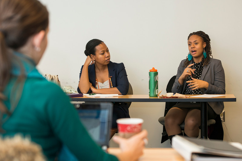 Students work in a Board of Directors Management 606 class taught by Professor Claire Huschle in the Graduate Arts Managment program at the Arlington campus. Photo by Alexis Glenn/Creative Services/George Mason University