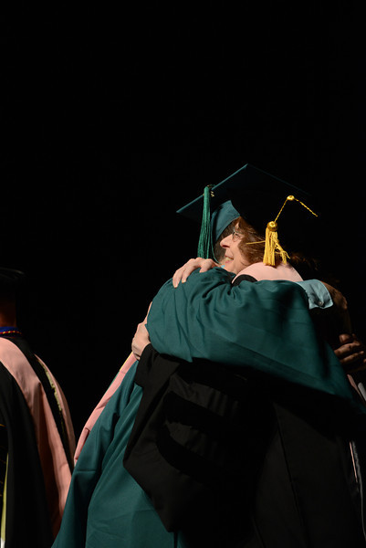 Professor Linda Monson congratulates a graduate. Photo by Evan Cantwell/Creative Services/George Mason University