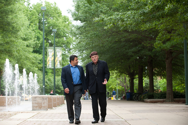 Actor Stacy Keach and Professor Ken Elston walk at Fairfax Campus. Photo by Alexis Glenn/Creative Services/George Mason University