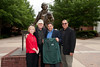 (L to R) Sally Merten, actor Stacy Keach, Professor Ken Elston and Professor Ed Gero at the Mason Statues at Fairfax Campus. Photo by Alexis Glenn/Creative Services/George Mason University