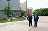 Actor Stacy Keach and Professor Ken Elston walk near the de Laski Performing Arts building at Fairfax Campus. Photo by Alexis Glenn/Creative Services/George Mason University