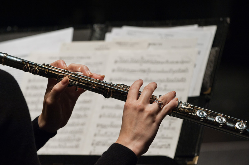 111018502 - Wind Symphony dress rehearsal, Concert Hall. Flute, hands, detail, music. Photo by Alexis Glenn/Creative Services/George Mason University