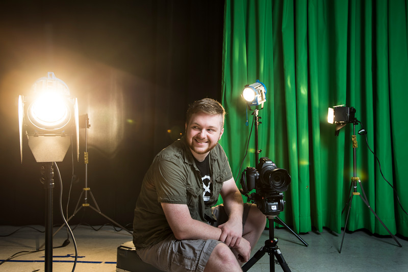 "Film and video studies major Jason Gilligan received a student production award from National Academy of Television Arts and Sciences National Capital Chesapeake Bay Chapter for his short film, ""Through the Trees' Eyes."" The film was produced for his Web Series class and he shares the recognition with the team that produced the film.  Photo by:  Ron Aira/Creative Services/George Mason University"