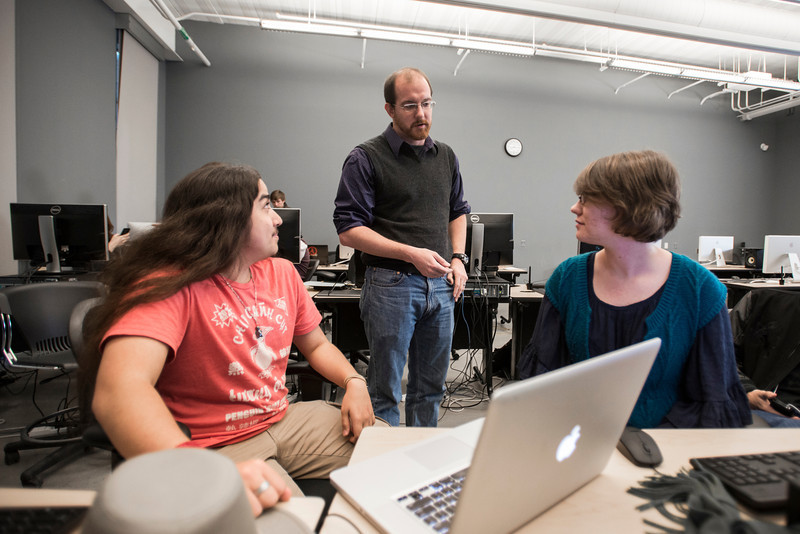 Professor Chris Totten works with students in his Online and Mobile Gaming 232 class at Fairfax campus. Photo by Alexis Glenn/Creative Services/George Mason University