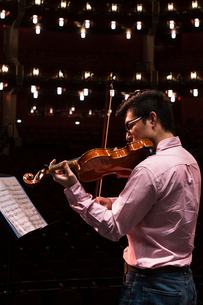 A George Mason student plays violin at the Hylton Performing Arts Center on George Mason University's Prince William campus. Photo by: Bethany Camp / Creative Services / George Mason University