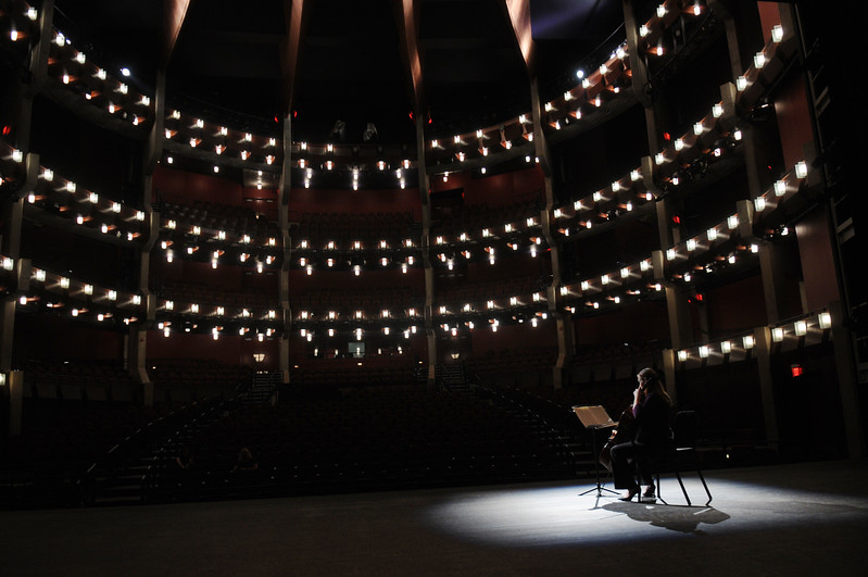 A cellist performs on stage at the Hylton Performing Arts Center on the Prince William Campus.