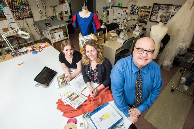 Howard Kurtz, Professor of Theater and head of the Theater Design program, right, is retiring at the end of the year, but he remains busy mentoring students like Alex Wade and Amanda Jarvis, left to right. Photo by:  Ron Aira/Creative Services/George Mason University