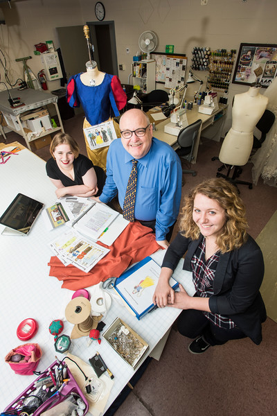 Howard Kurtz, Professor of Theater and head of the Theater Design program, center, is retiring at the end of the year, but he remains busy mentoring students like Alex Wade and Amanda Jarvis, left and right. Photo by:  Ron Aira/Creative Services/George Mason University