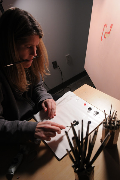 School of Art graduate student working in the studio. Photo by Evan Cantwell/Creative Services/George Mason University