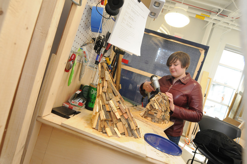 Senior Art major, Kelly Criscuolo-DeButts, works on a project in the sculpture studio in the Art and Design Building on the Fairfax Campus.  Photo by Creative Services/George Mason University