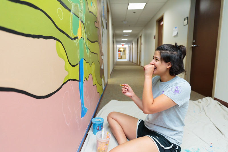 Mason Mural Brigade painting hallway at MBT. Photo by Ian Shiff/Creative Services/George Mason University