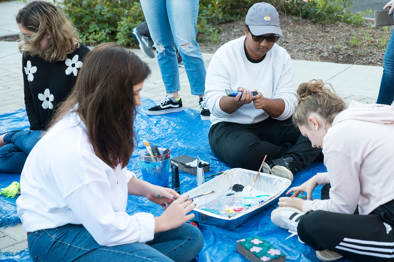 Students and community members paint bricks at the Contemporary Mural Arts Festival. Photo by Bethany Camp/Creative Services/George Mason University