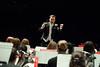 Adam Hilkert, Associate Conductor, Symphonic Band, conducts the Symphonic Band as they perform at the Concert Hall on Fairfax Campus. Photo by Alexis Glenn/Creative Services/George Mason University
