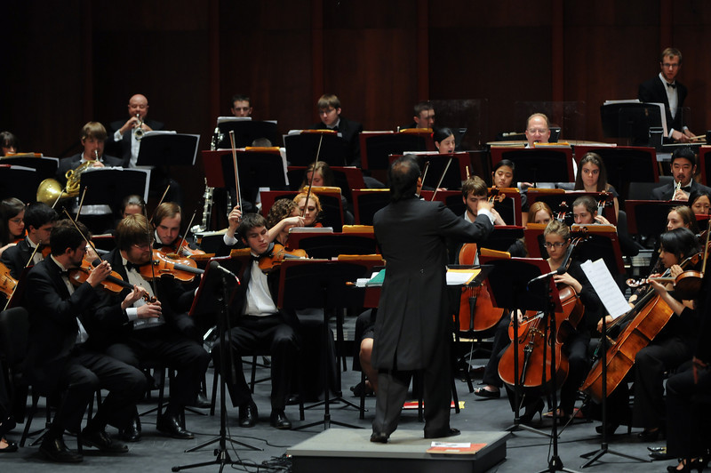 Guest conductor Igor Sarmientos directs the Mason Symphony Orchestra on the Hylton Performing Arts Center stage.