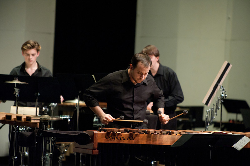 John Kilkenny, Conductor, Percussion Ensemble, performs with the Percussion Ensemble at the Concert Hall on Fairfax Campus. Photo by Alexis Glenn/Creative Services/George Mason University