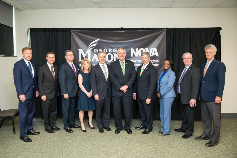 Mason Rector Tom Davis (from left), Northrop Grumman CEO and President Wes Bush, Vencore President and CEO Mac Curtis, Mason Vice President for Academic Innovation and New Ventures Michelle Marks, George Mason University President Ángel Cabrera, Virginia Gov. Terry McAuliffe, NOVA President Scott Ralls, Virginia Secretary of Education Dietra Trent, NOVA Board Chair Todd Rowley and SCHEV Director Peter Blake at Tuesday's ADVANCE partnership announcement.  Photo by:  Ron Aira/Creative Services/George Mason University