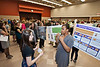Communications major Serene Mitchell (R) speak to Hanna King about her poster at the Honors College Research Exhibition poster presentations of 300 students at The Hub, at Fairfax Campus. Photo by Alexis Glenn/Creative Services/George Mason University