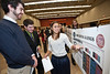Psychology major Priya Keathley speaks about her poster at the Honors College Research Exhibition poster presentations of 300 students at The Hub, at Fairfax Campus. Photo by Alexis Glenn/Creative Services/George Mason University