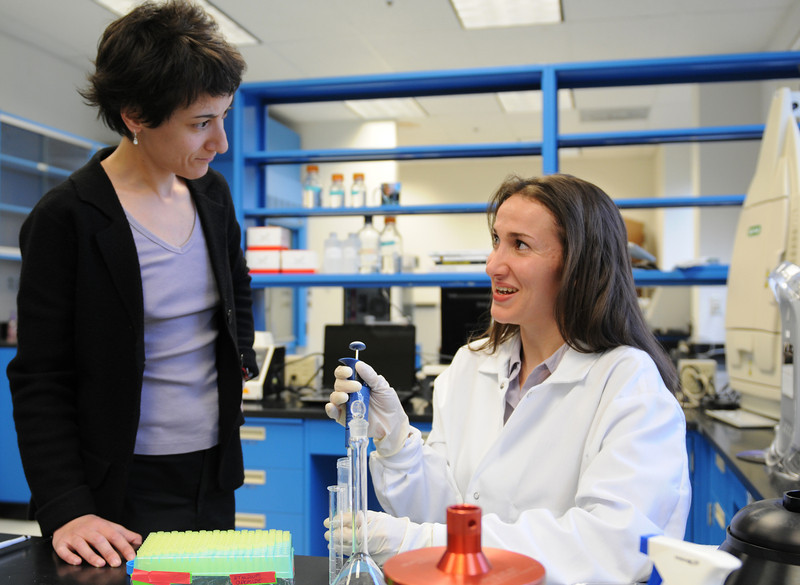 Student Michelle Raiszadeh, right, with Professor Nadine Kabbani in the lab at Krasnow Institute. Photo by Evan Cantwell/Creative Services/George Mason University
