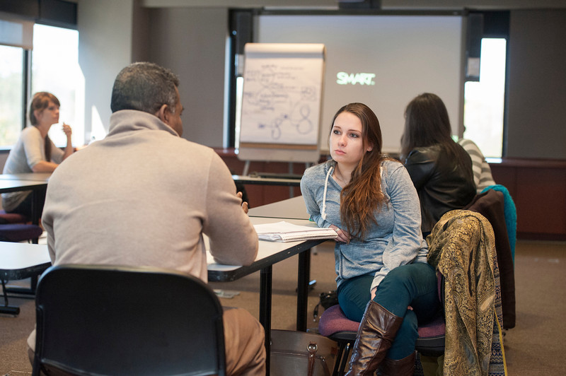 Students work in an Insights Lab at the School for Conflict Analysis and Resolution at the Arlington Campus. Photo by Alexis Glenn/Creative Services/George Mason University