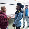 S-CAR professor Arthur Romano (behind) conducts a workshop, for the State Department, on peace building skills to professional hip hop DJs from around the world.  Photo by:  Ron Aira/Creative Services/George Mason University
