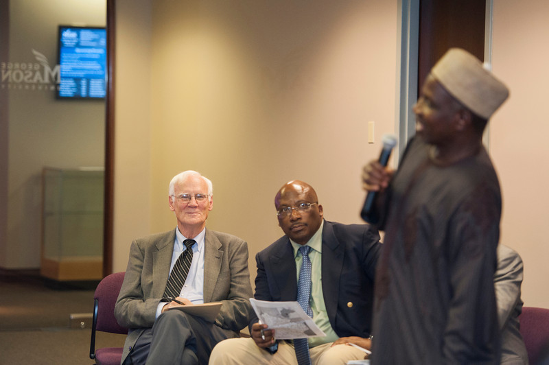 Robinson Professor John Paden participates in a discussion with the Nigerian delegation and guests at the NIPSS/S-CAR conference at the Arlington campus. Photo by Alexis Glenn/Creative Services/George Mason University