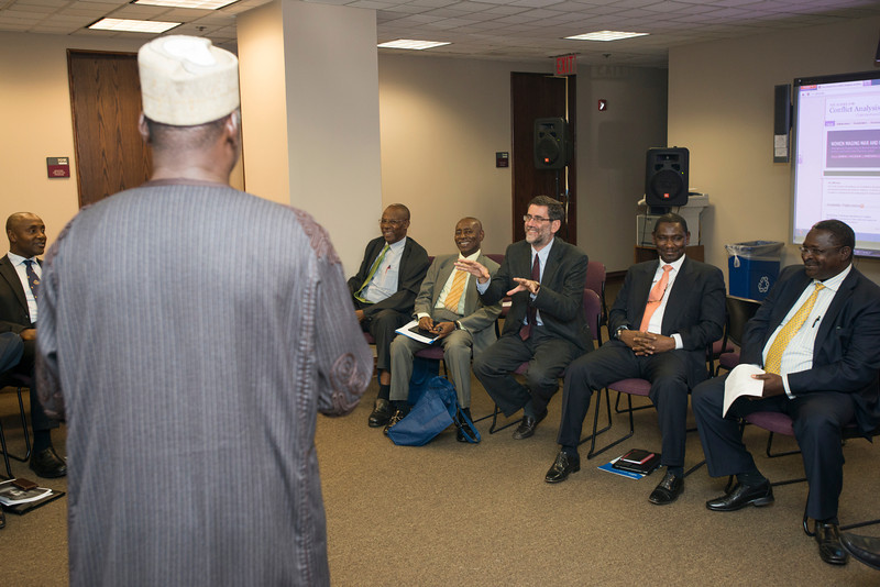 S-CAR Dean Andrea Bartoli participates in a discussion with the Nigerian delegation and guests at the NIPSS/S-CAR conference at the Arlington campus. Photo by Alexis Glenn/Creative Services/George Mason University