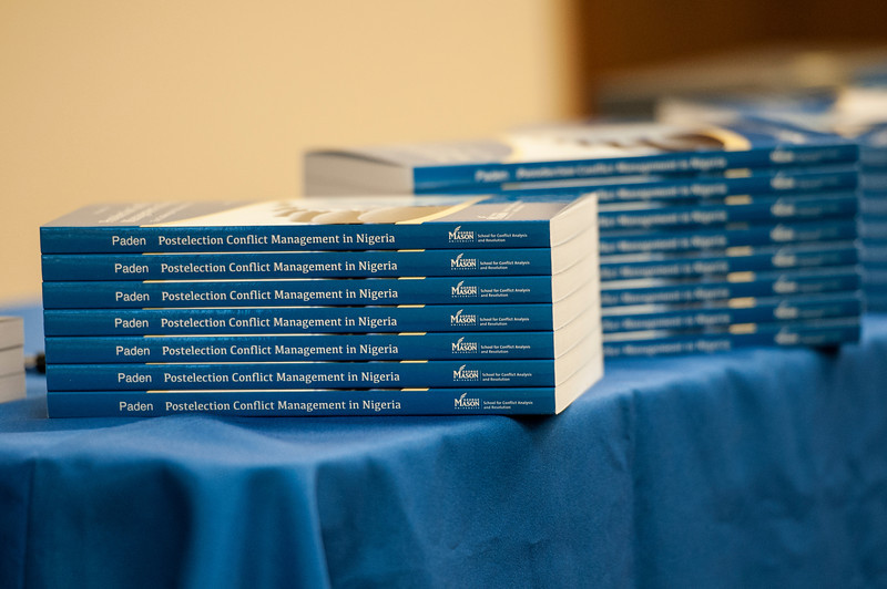 Books, written by Robinson Professor John Paden, are displayed at the NIPSS/S-CAR conference at the Arlington campus. Photo by Alexis Glenn/Creative Services/George Mason University